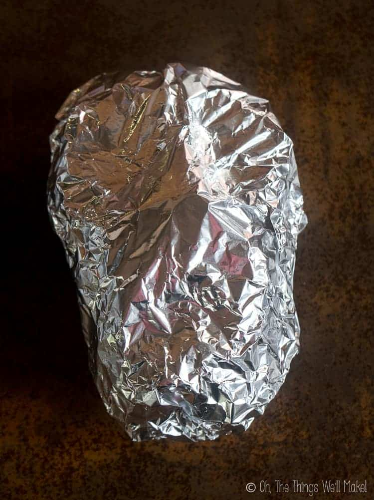 the face shape covered with another piece of aluminum foil