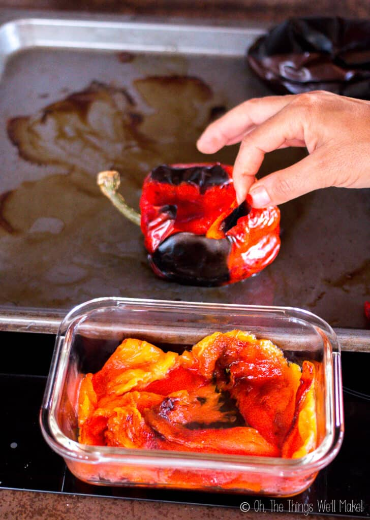 Peeling the char-broiled skin off the roasted peppers