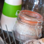 a jar with fish in the dishwasher, ready for cooking