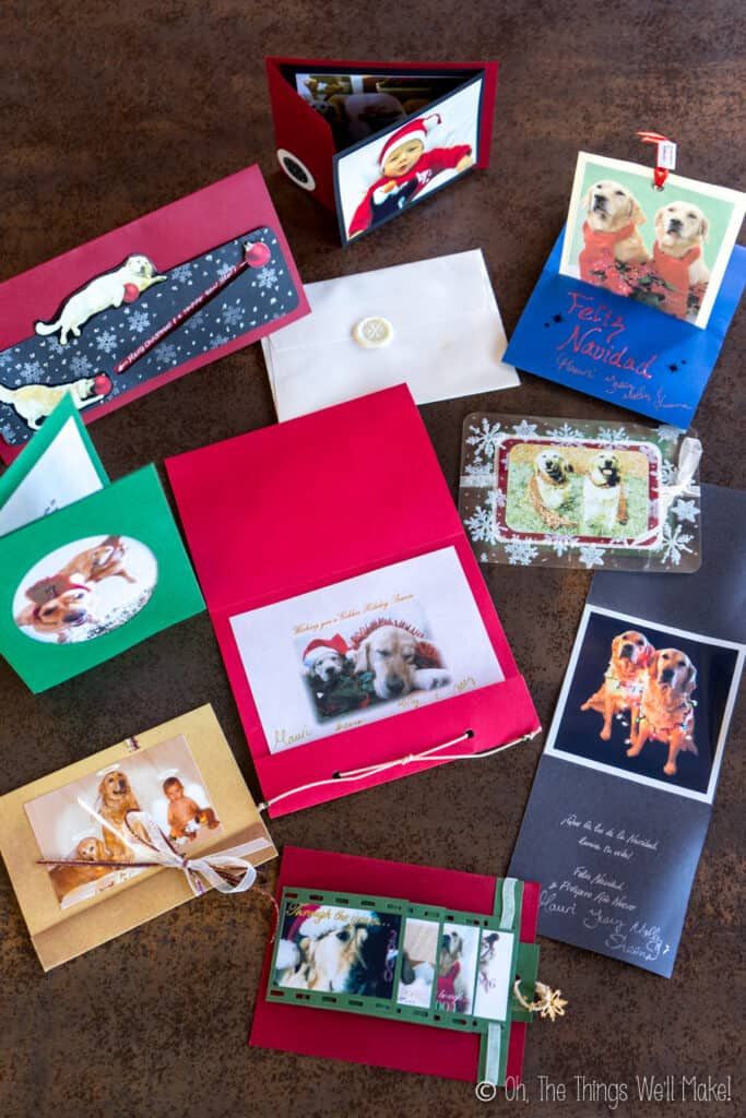 Overhead view of 9 handmade Christmas cards using photos