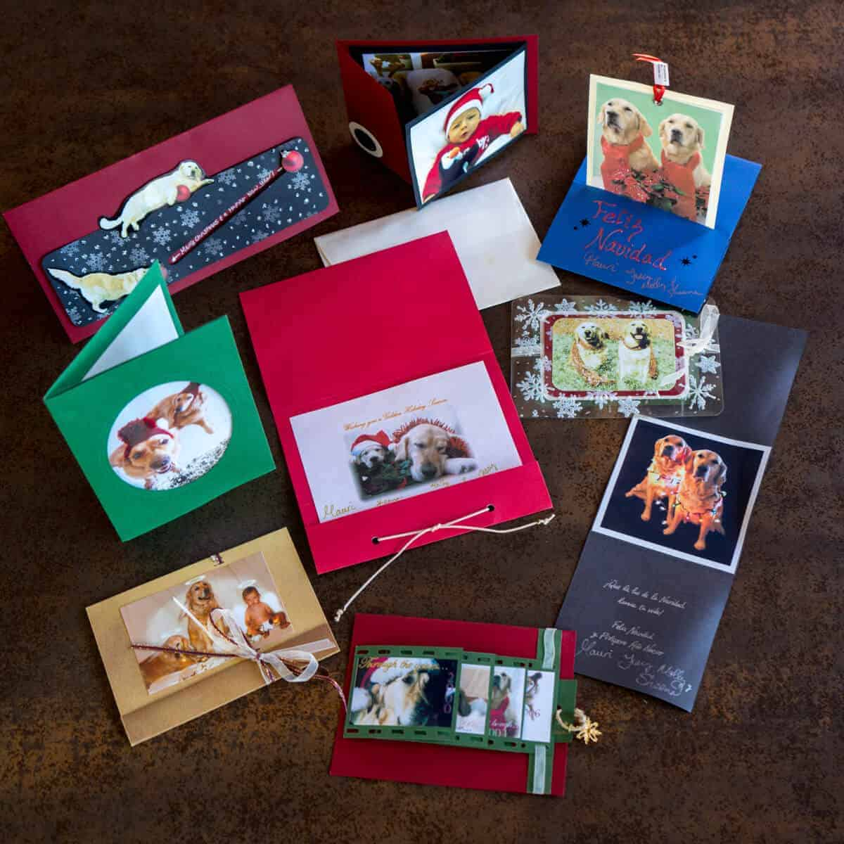 Overhead view of 9 handmade Christmas cards using photos