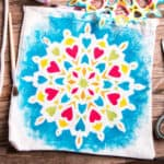A bag with a hand-painted mandala design on it