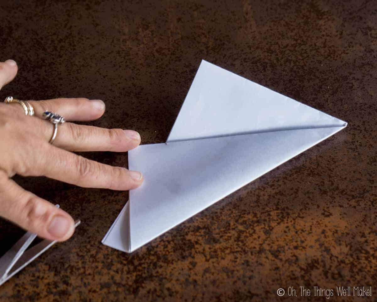 Folding up one of the thirds of the rectangular piece of paper