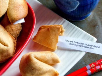 "Overhead view of several homemade fortune cookies. One has been opened to show a fortune that reads ""You are fortunate to have found thethingswellmake.com""."