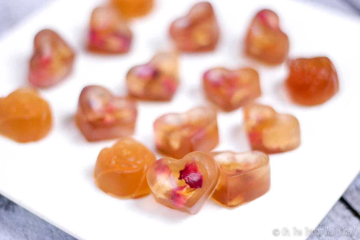 Close up of rose petal gummies on a plate.