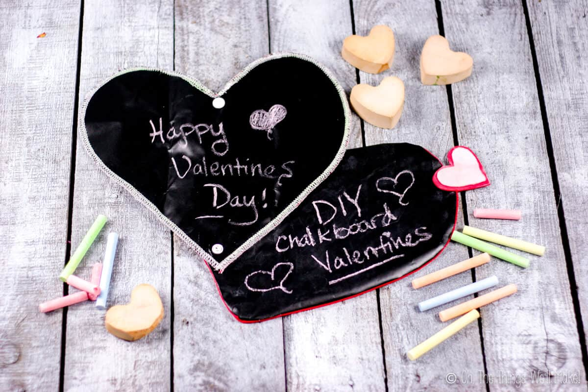 Two heart chalkboards, one made with a serger above a heart chalkboard made with a regular sewing machine.