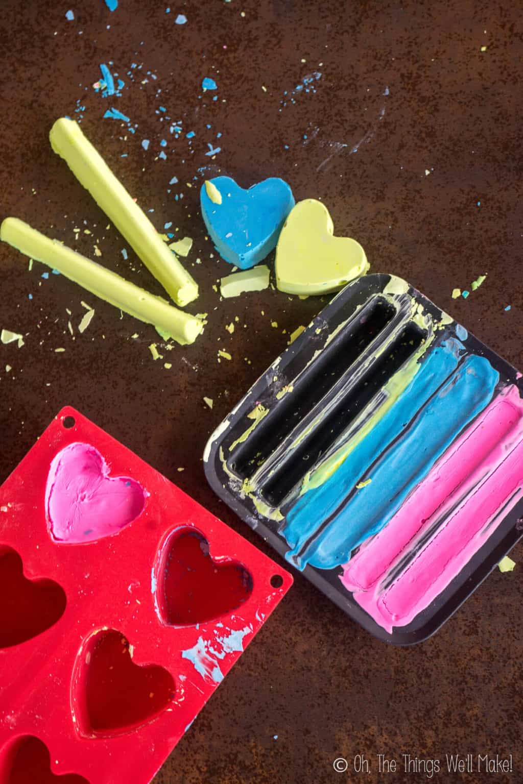 Close up of colorful chalk that has been taken out of the molds. Several pieces still remain in the molds