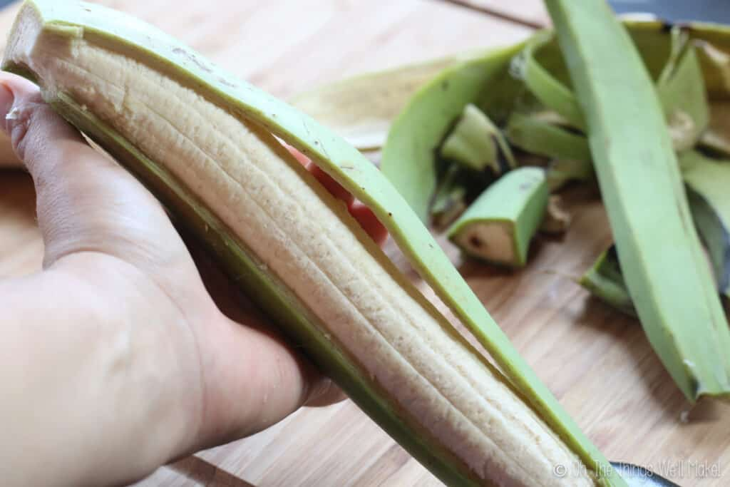 peeling a green plantain