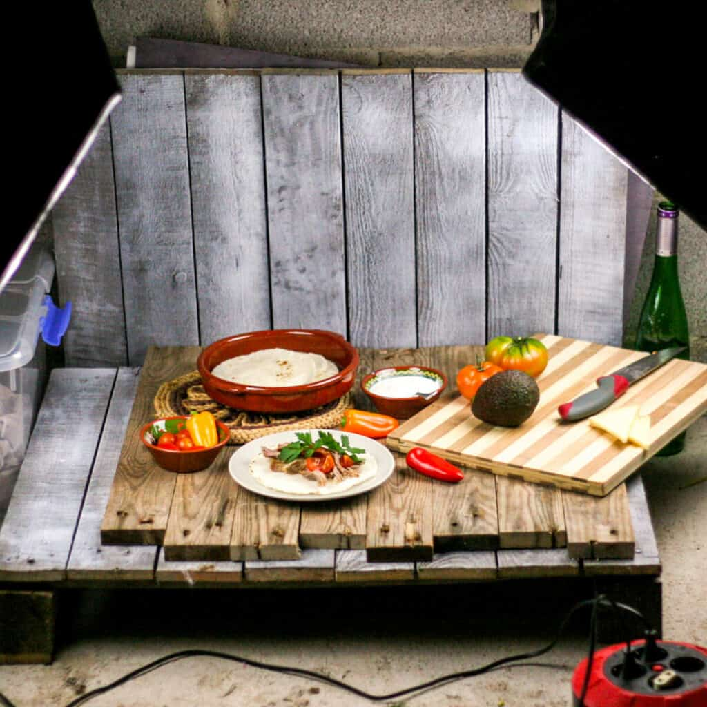 "A homemade pallet ""studio"" with artificial lights set up to take pictures of homemade carnitas."