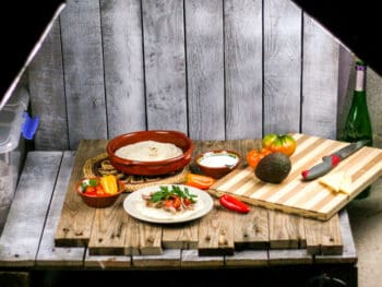 """A homemade pallet """"studio"""" with artificial lights set up to take pictures of homemade carnitas."""