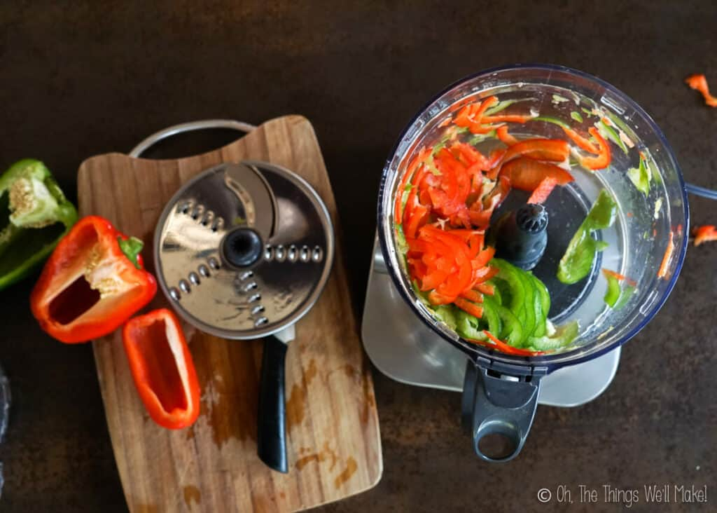slicing the bell peppers in a food processor