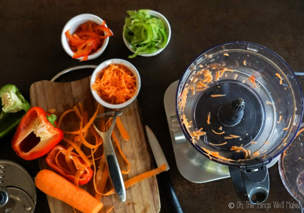 Grating a carrot in a food processor.
