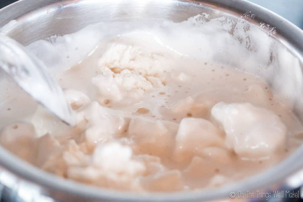 melting the marshmallows in a pan.