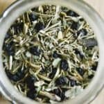 overhead view of mixed herbal tea leaves including dried nettle leaves