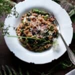 Overhead view of a bowl of risotto with asparagus and nettles