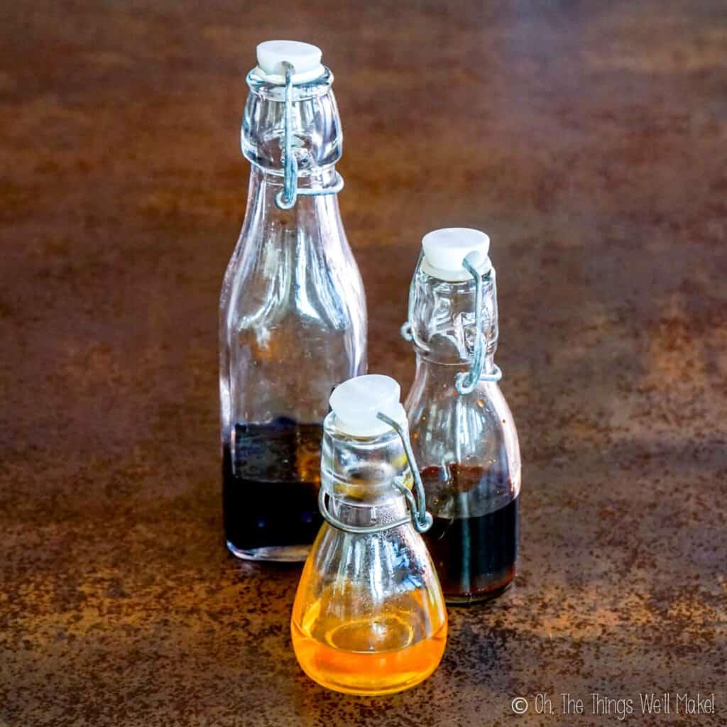 3 small glass bottles with homemade food colorings.