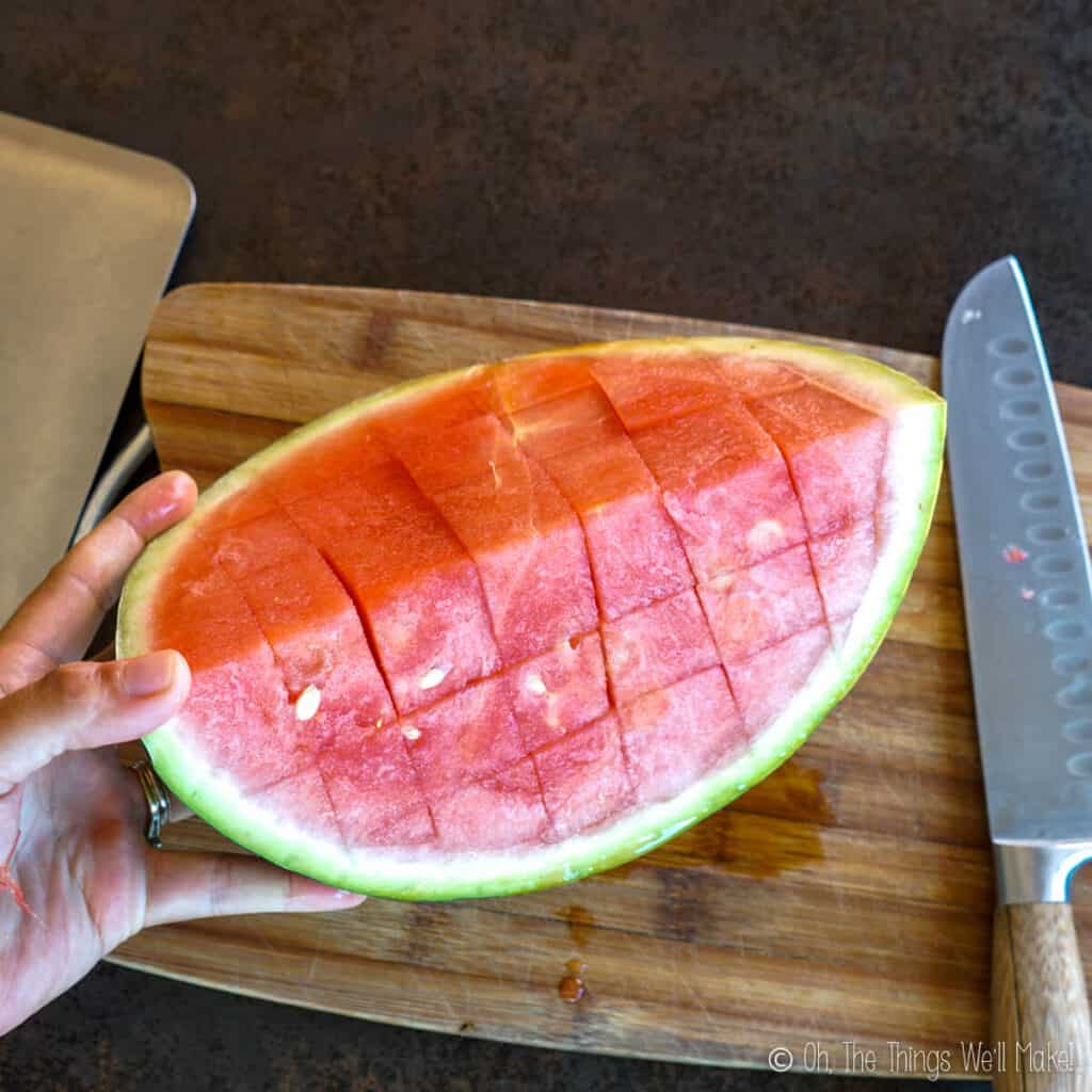 A quarter of a watermelon that has been cut into cubes.