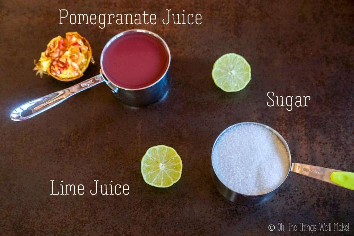 Overhead view of the ingredients needed to make homemade grenadine: pomegranate juice, sugar, and lime juice.