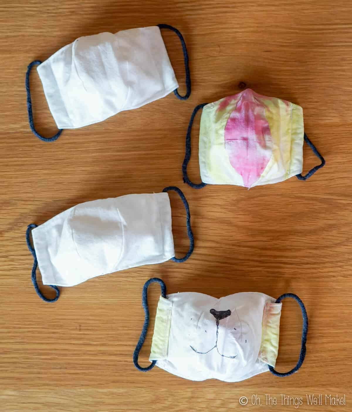 Overhead view of 4 cloth face masks
