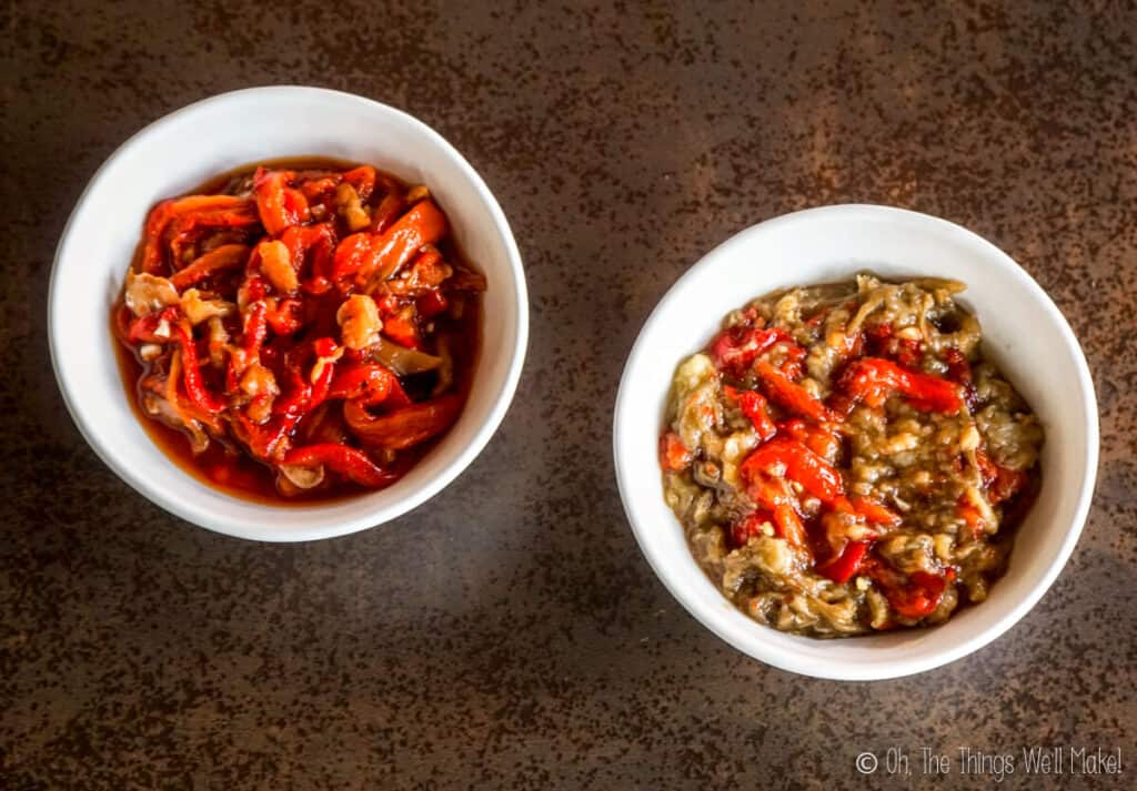 Overhead view of 2 bowls of roasted vegetables. The one on the left is esgarraet made with only red peppers. The one on the right is filled with espencat (roasted eggplant and red peppers).