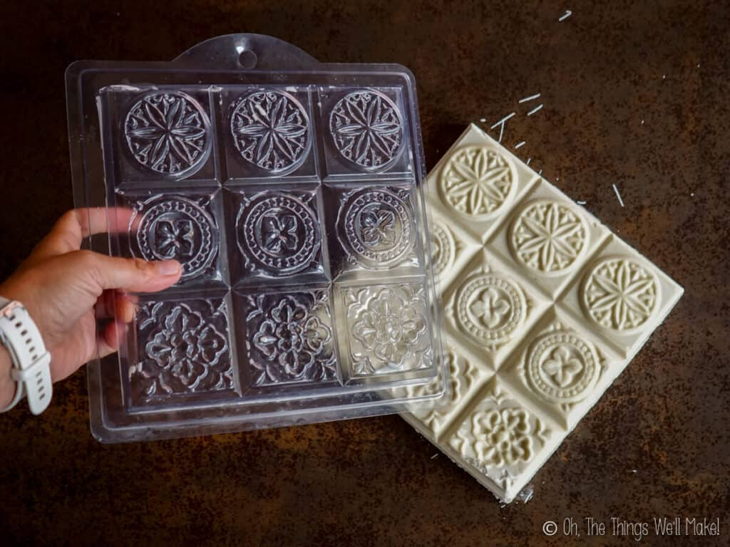 Pulling the soap mold off the newly unmolded soap