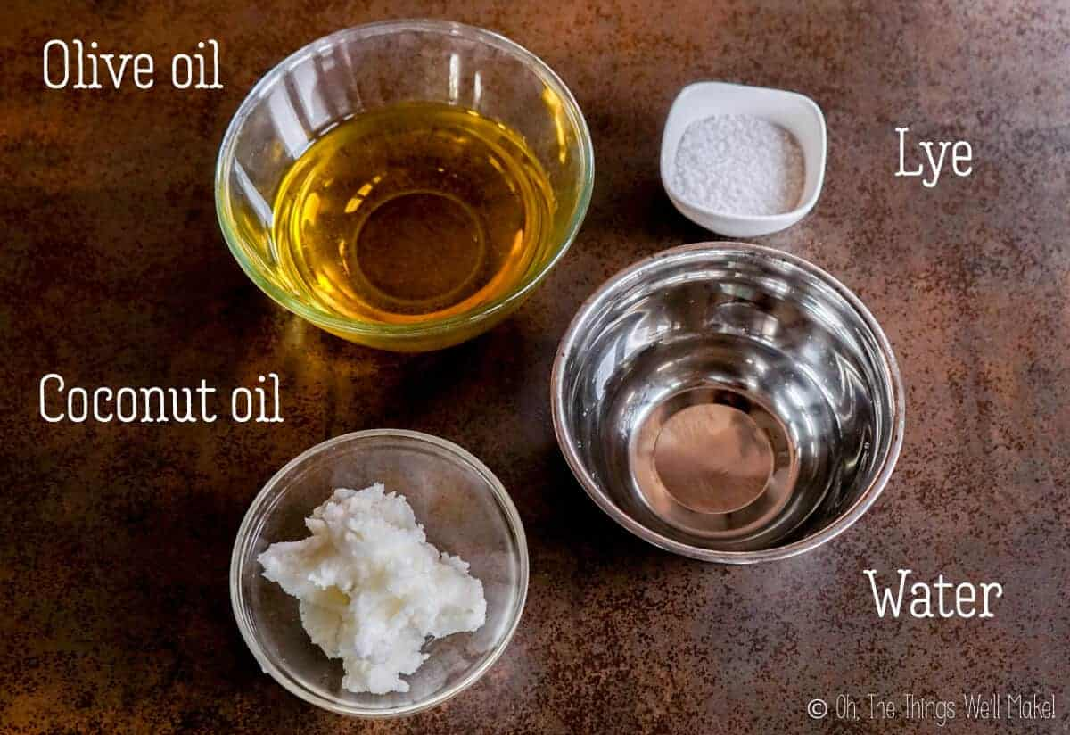 Overhead view of olive oil, coconut oil, lye, and water