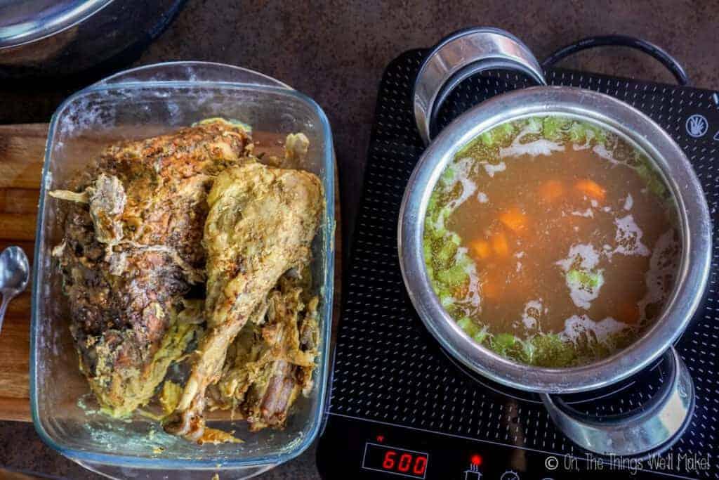 A pan of leftover turkey next to a pot of turkey soup