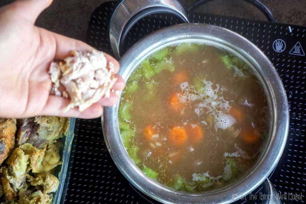 Adding turkey pieces to the soup