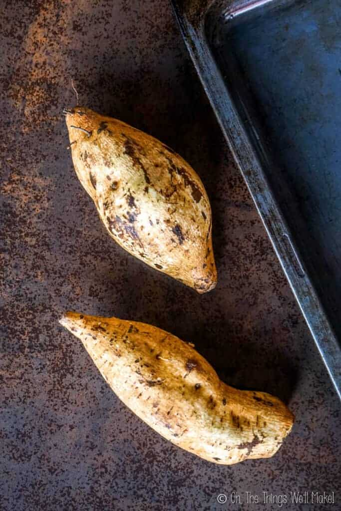 Overhead view of 2 baked white sweet potatoes