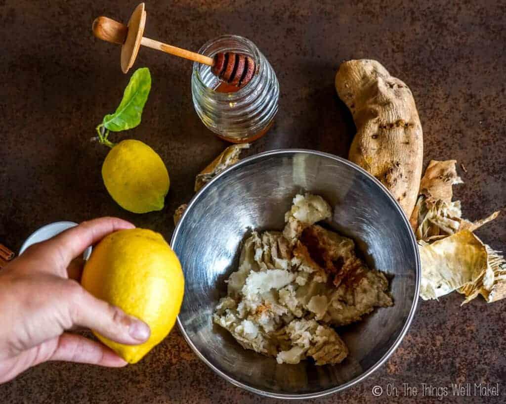 Add lemon zest to a bowl of mashed white sweet potato