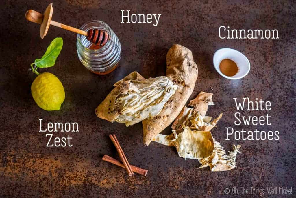 Overhead view of the ingredients for dulce de boniato: Baked white sweet potatoes, cinnamon, honey, and lemon zest.