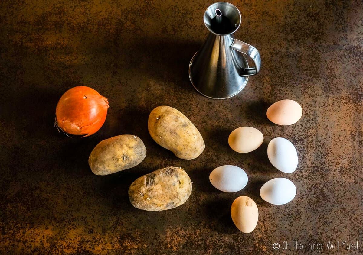 Overhead view of the ingredients for a Spanish tortilla.