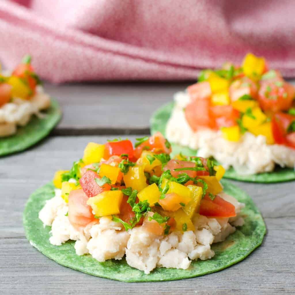 3 Mexican tortilla mini pizzas made with green spinach tortillas topped with veggies