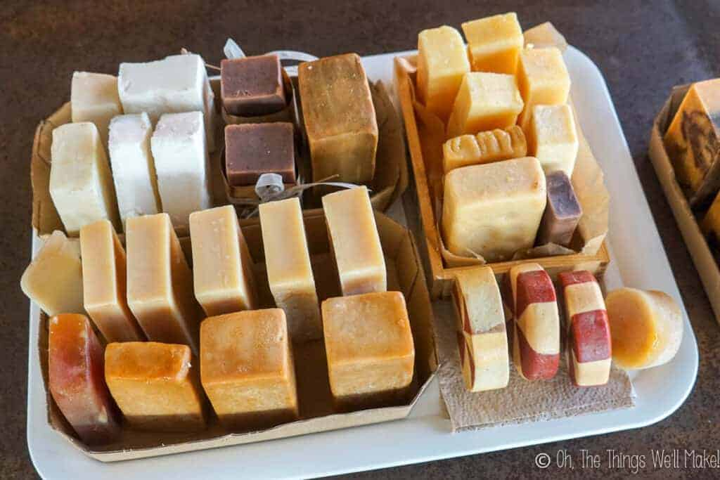 Overhead view of many groups of soaps curing on a tray