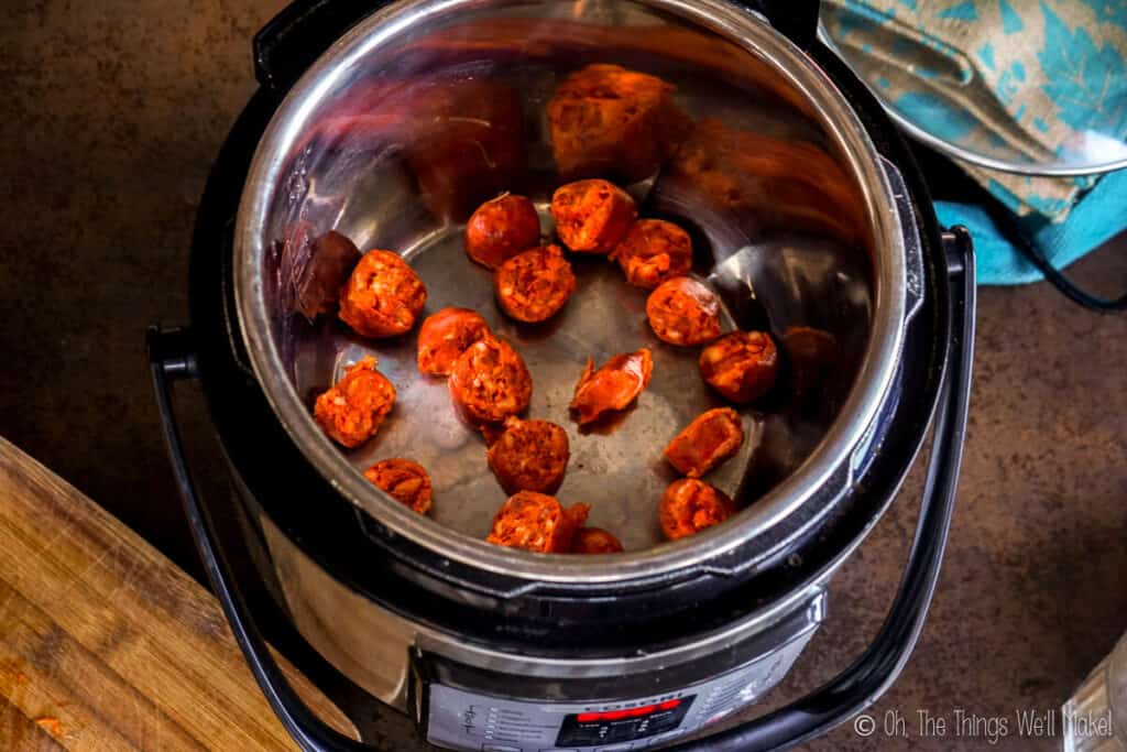 the sliiced chorizo in a pressure cooker