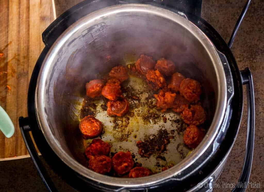 The cooked chorizo in the pressure cooker
