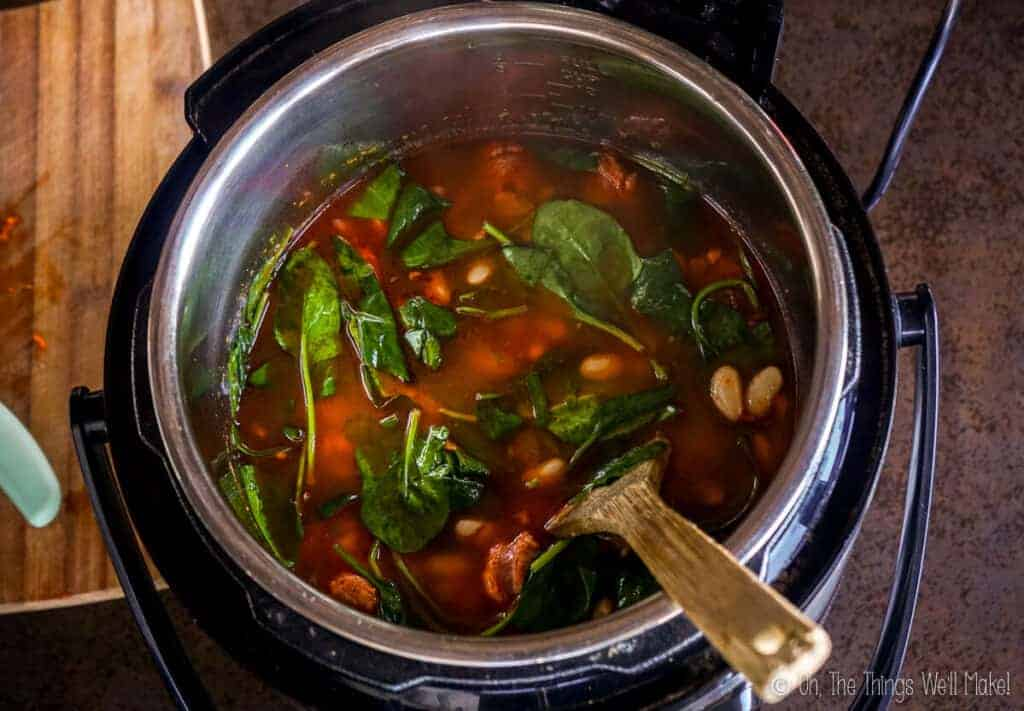 Overhead view of the cooked soup with the wilted spinach