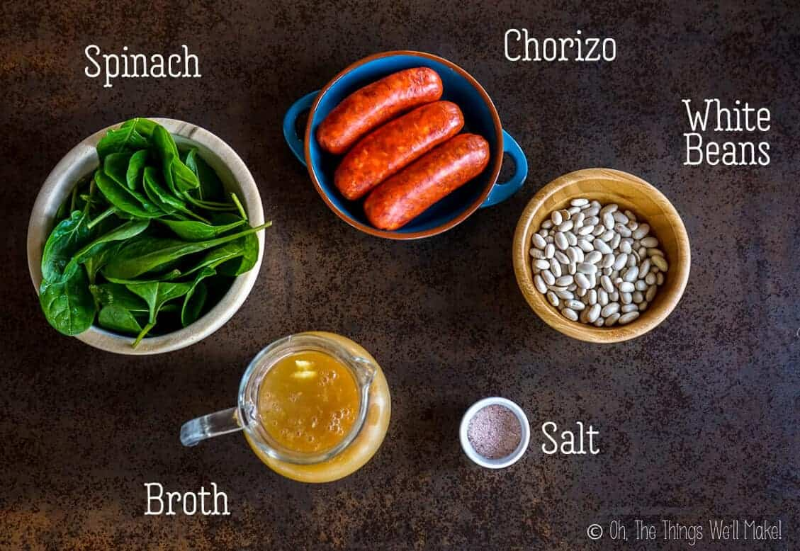 Ingredients for a white bean and chorizo soup with spinach