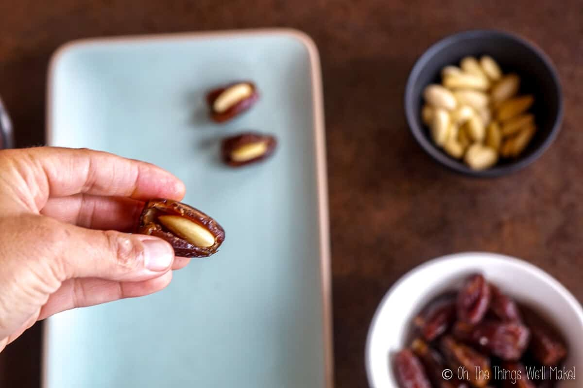stuffing almonds into dates