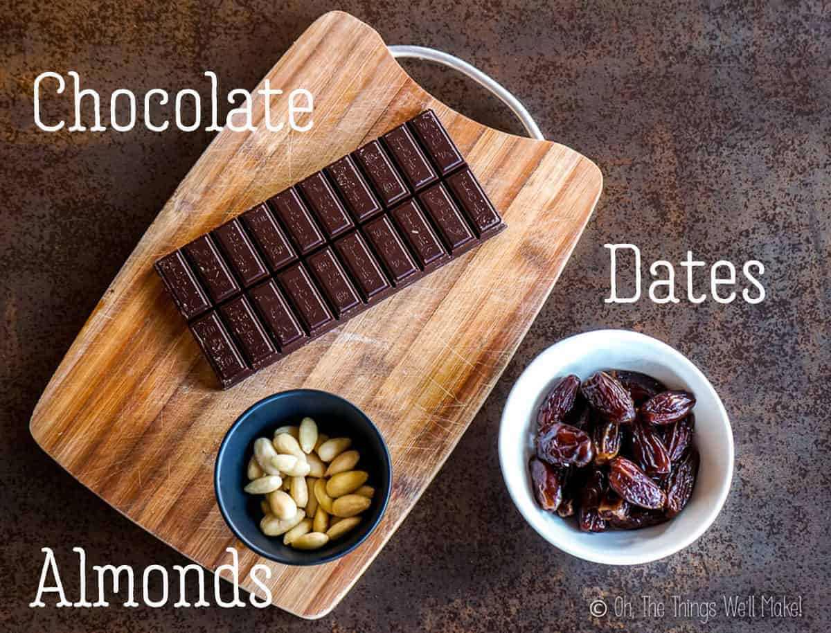 overhead view of the ingredients for chocolate covered dates with almonds