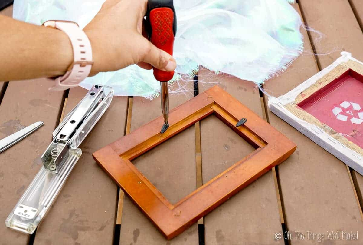 Removing the screws of an old picture frame