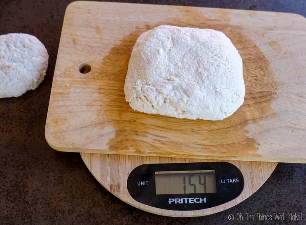 154g of whole milk paneer on a scale