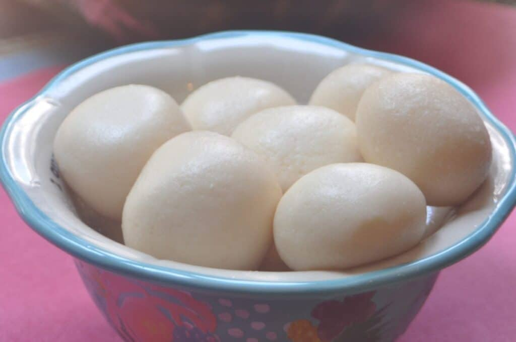 a bowl filled with rasgulla balls