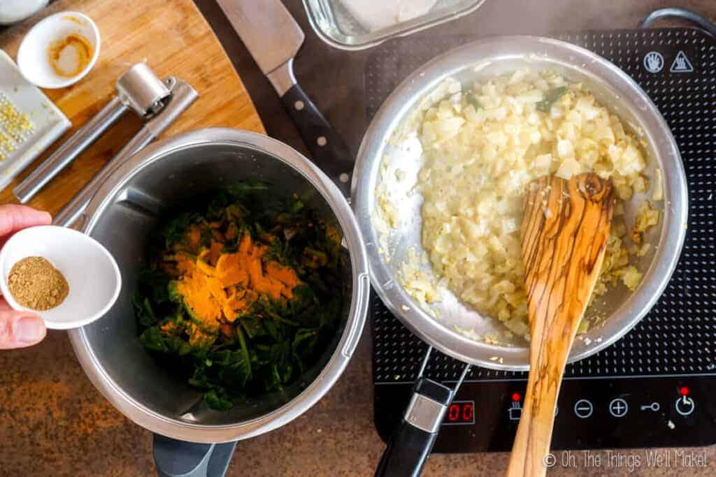 Adding the garam masala to the spinach
