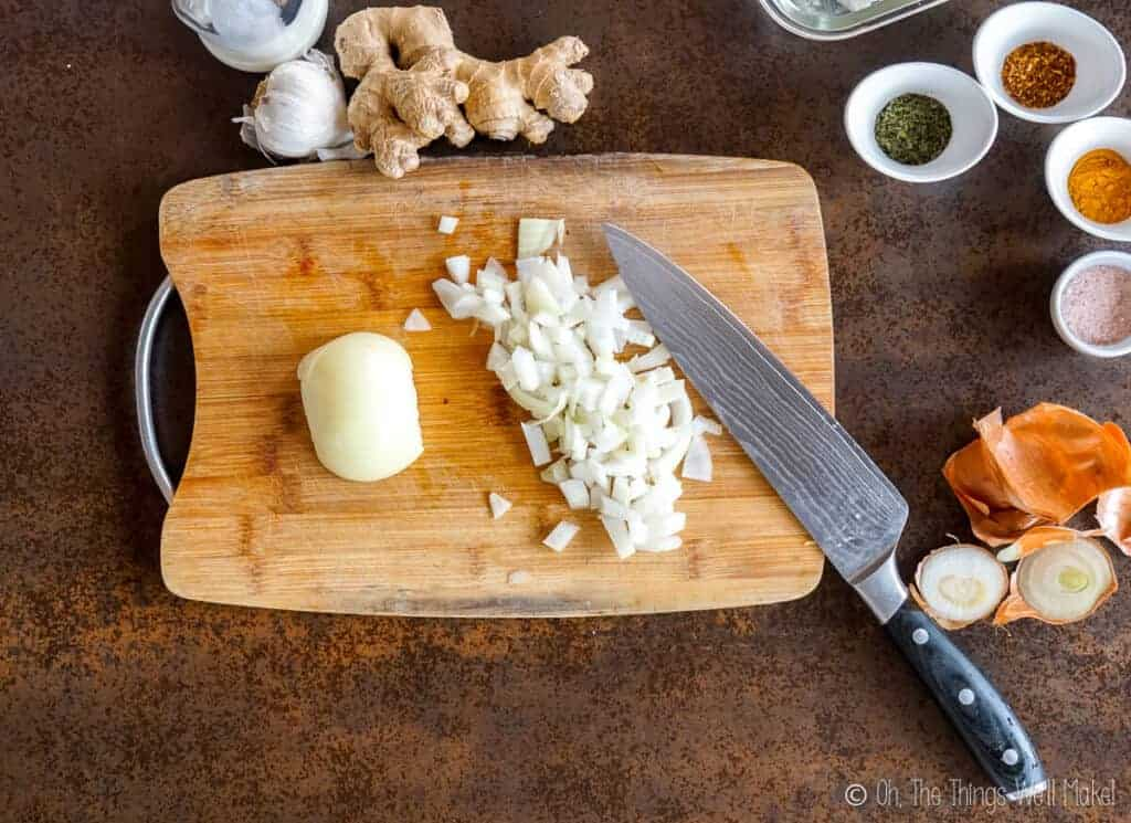 Chopping an onion on a bamboo cutting board