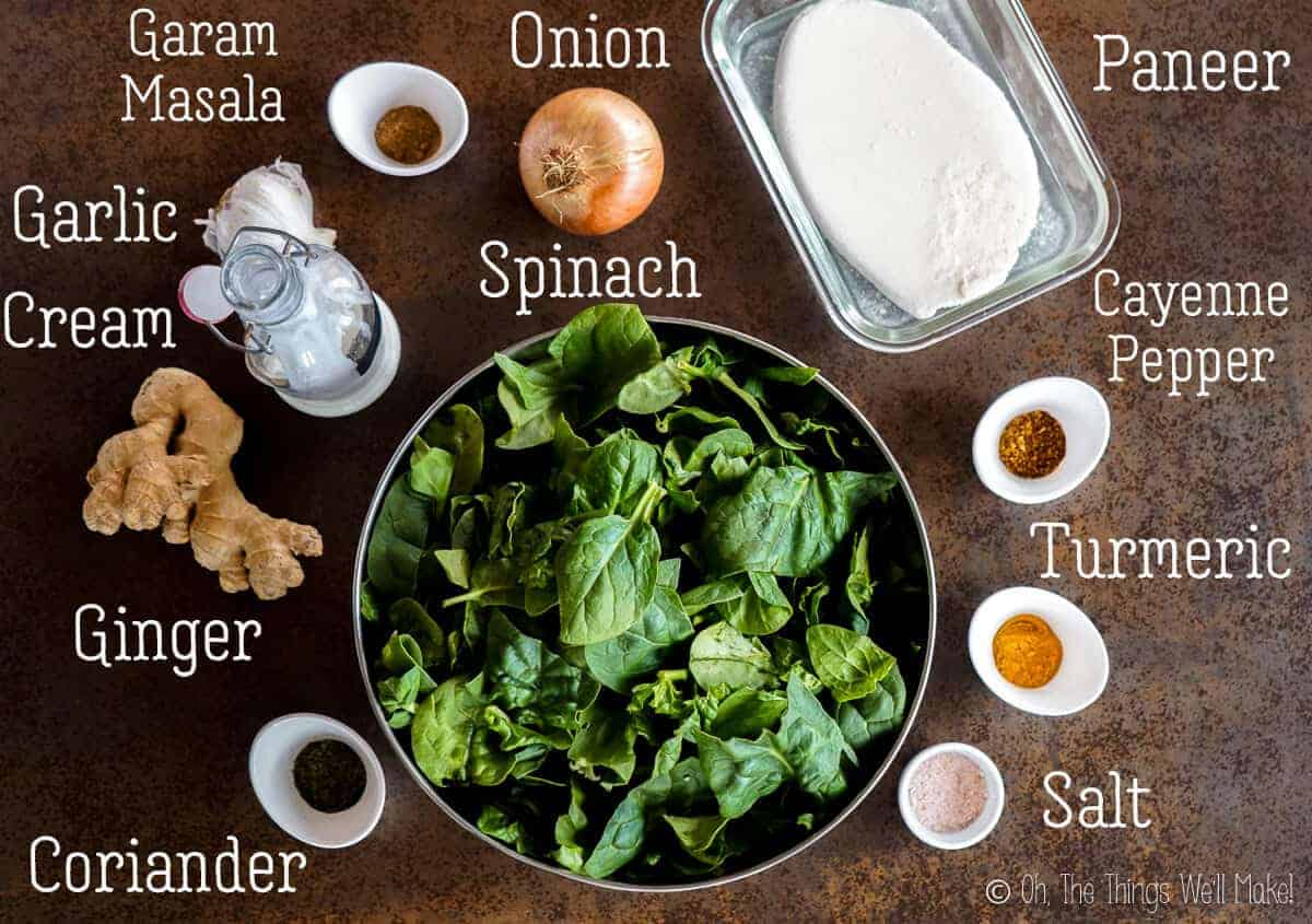 Overhead view of the ingredients for palak paneer