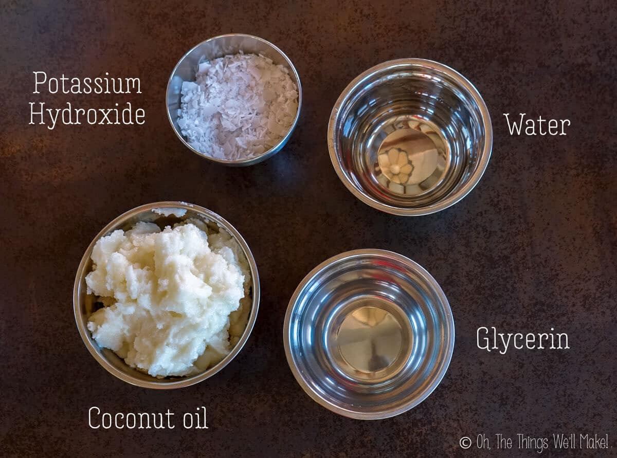 Overhead view of ingredients for a homemade liquid soap made with coconut oil