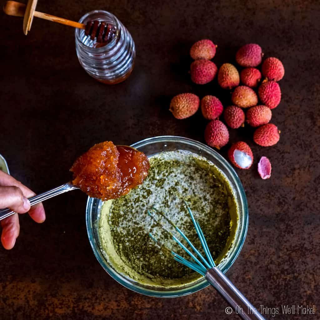 Adding honey to the matcha and cream mixture
