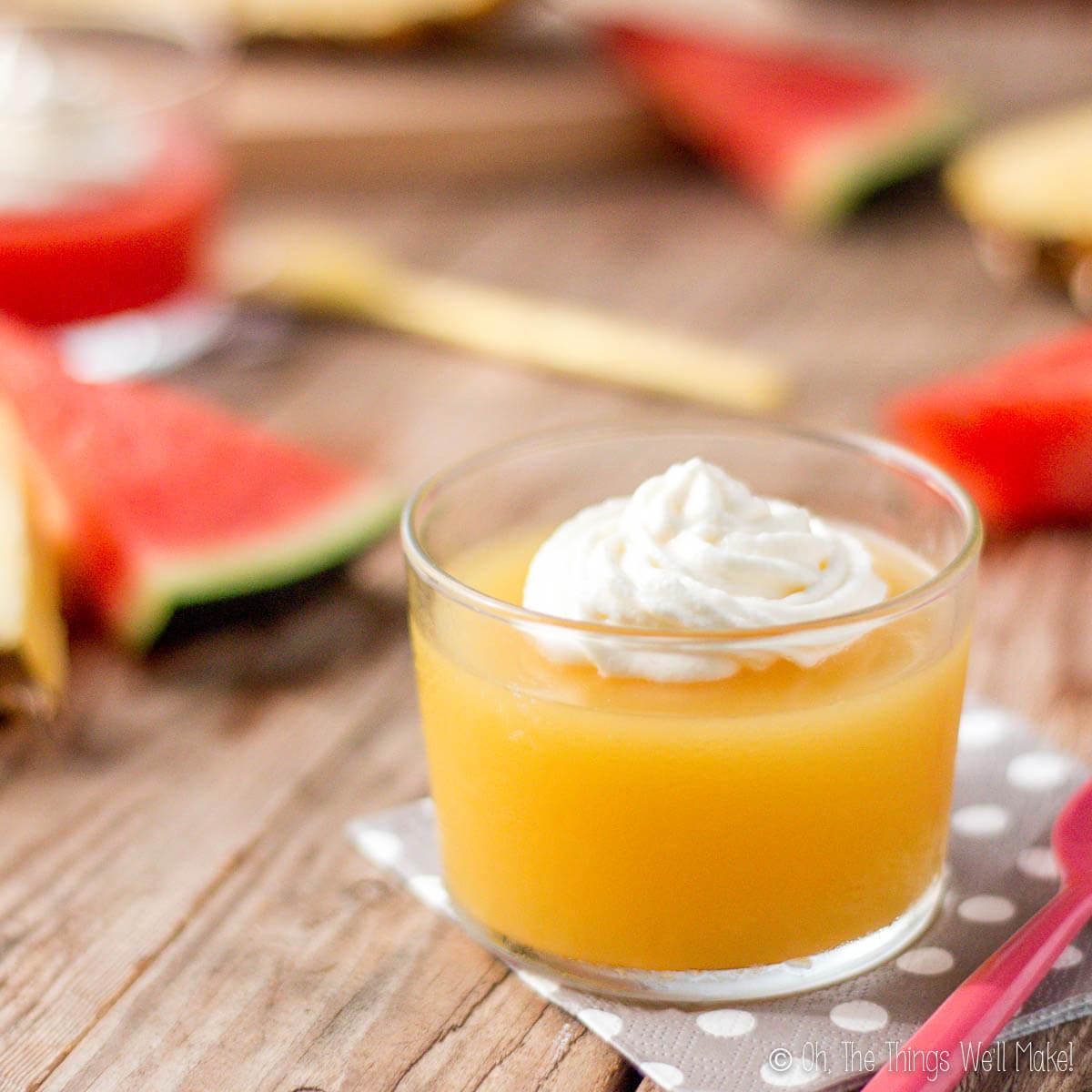 Closeup of homemade pineapple gelatin in front of homemade watermelon gelatin.