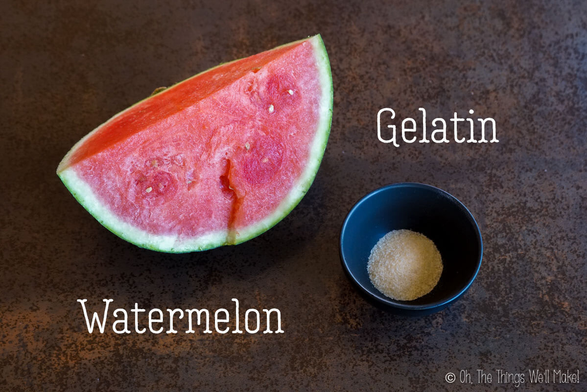 Overhead view of a quarter of a watermelon and some gelatin powder.